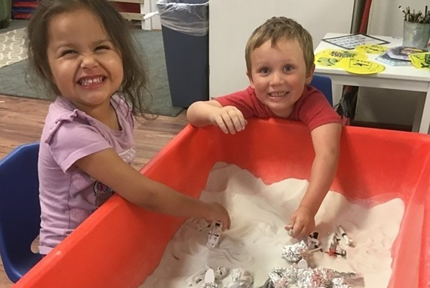 children playing in sensory box at a Preschool & Childcare Serving Salt Lake City, UT