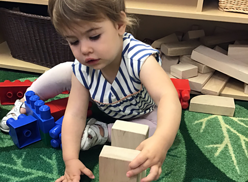 toddler playing in classroom at a Preschool & Childcare Serving Salt Lake City, UT